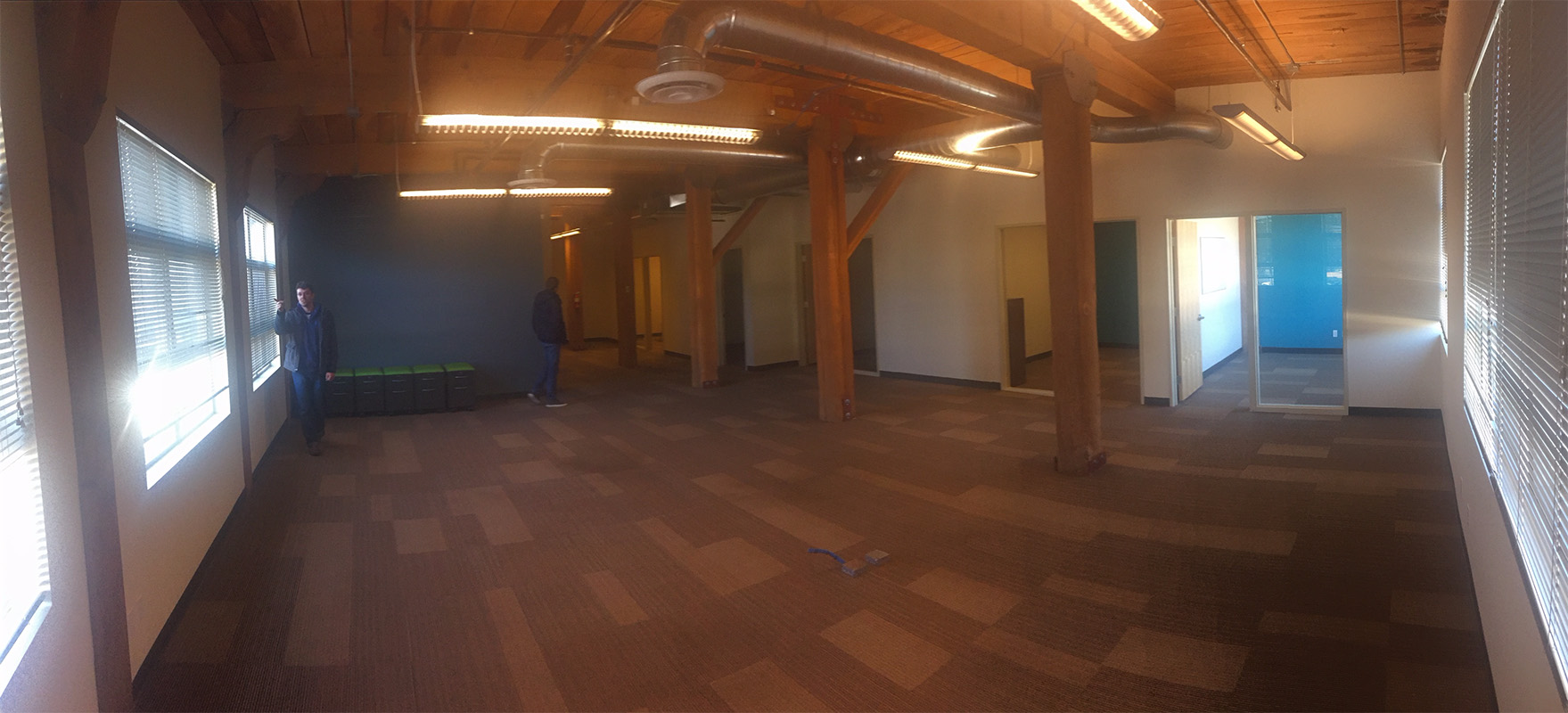 A couple of us checking out our new office before the official move-in. That's me on the left.